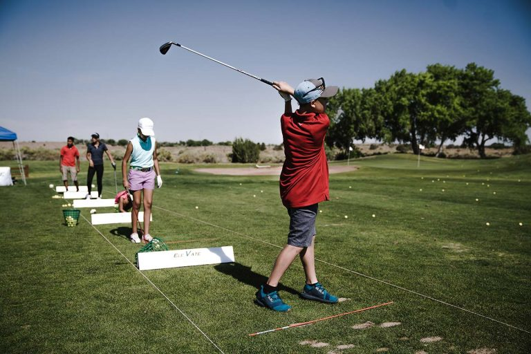 Young golfer at the driving range